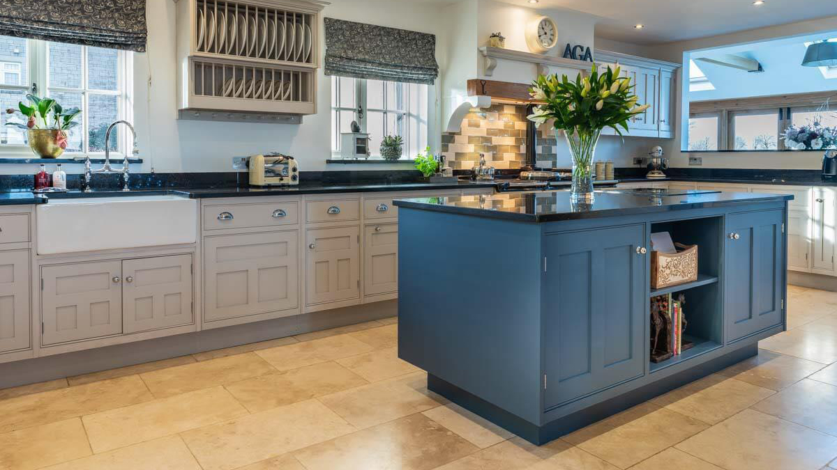painted kitchen in wiltshire, Cornforth White on the main cabinets and the island in Farrow and Ball stiffkey blue